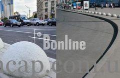 Антипарковочные бетонные полусферы.